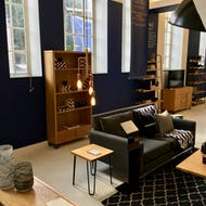 A bookcase and a sofa at Heal's