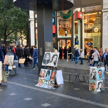 Portraits  made by street artists on Leicester Square