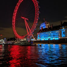 London Eye at night from a river cruise