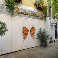 Angel wings on the wall of Redemption bar