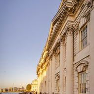 Old Royal Naval College buildings next to the Thames
