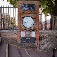 The 24-hour gate clock and measures for a foot and a yard