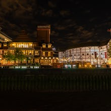 Shakespeare's Globe at night as seen from a Thames Clipper peer