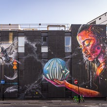 The bicycle shows the scale of this amazing mural by Mr Cenz and Lovepusher on New Inn Yard