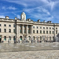 People walking next to the fountain at Somerset House