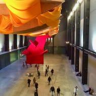 People walking in the Turbine Hall of Tate Modern
