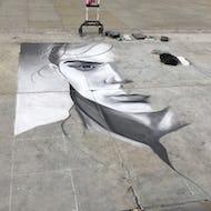 Street artist drawing